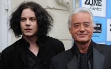 """American musician Jack White (L) and rock guitar legend Jimmy Page (R) arrive at the Los Angeles Film Festival for the premiere of """"It Might Get Loud,"""" at the Mann Festival Theatre in Los Angeles, California on June 19, 2009. Picture: AFP."""