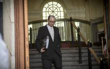 State Prosecutor Adrian Mopp makes his way down the front steps of the Western Cape High Court after Judge Traverso announced she would be delivering her judgment on the Defence's application for a dismissal on Dec 8, 2014. Picture: Thomas Holder/EWN