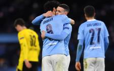 Manchester City's Phil Foden (2R) celebrates scoring his team's second goal with Ilkay Gundogan during the UEFA Champions League first leg quarterfinal football match between Manchester City and Borussia Dortmund at the Etihad Stadium in Manchester, north west England, on 6 April 2021. Picture: Paul Ellis/AFP