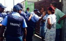 Police conducted a walkabout in Hanover Park on 6 January 2015. Picture: Shamiela Fisher/EWN.