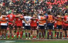 Sunwolves and Reds players observe a minute of silence for victims of the mosque attacks in Christchurch before their Super Rugby match at the Prince Chichibu Memorial Stadium in Tokyo on 16 March 2019. Picture: AFP