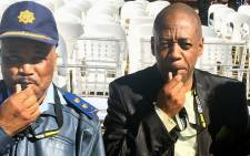 Gauteng Deputy Police Commissioner Major-General Phumzo Gela (Left) and Gauteng CPF chairman Andy Mashaile blow the whistle on crime at an anti-crime event in Reiger Park on 24 August 2014. Picture: Crime Line