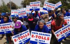 FILE: Members of the Democratic Alliance march against the implementation of e-tolls on 27 September, 2013. Picture: EWN.