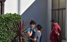 A TraderJoe's employee is comforted after a suspect barricaded inside the supermarket in Silverlake, Los Angeles, on 21 July, 2018. Picture: AFP.