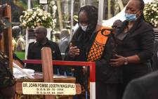 Maria Nyerere (2R), the widow of the first Tanzanian President Mwalimu Julius Nyerere, mourns during the national funeral of the fifth Tanzanian president John Magufuli at Uhuru Stadium in Dar es Salaam, on March 20, 2021. Picture: AFP.