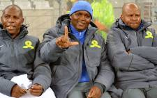 Sundowns coach Pitso Mosimane gestures his team's symbolic 'sky is the limit' sign on 13 August 2014. Picture: Abed Ahmed/EWN