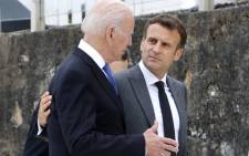 In this file photo, US President Joe Biden (L) and France's President Emmanuel Macron speak after the family photo at the start of the G7 summit in Carbis Bay, Cornwall on 11 June 2021. Picture: Ludovic Marin/AFP