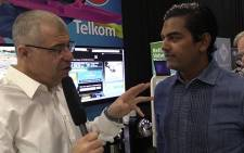 EWN's Aki Anastasiou checks out Telkom's new product launches at the MyBroadband conference in Midrand. Picture: Vumani Mkhize/EWN