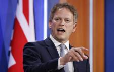 FILE: Britain's Transport Secretary Grant Shapps gives a virtual press conference inside the new Downing Street Briefing Room in central London on 7 May 2021. Picture: Tolga Akmen/AFP