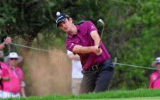 File: Briton Justin Rose returned a seven-under 65 to grab the first-round lead at the Arnold Palmer Invitational on 21 March 2013. Picture: AFP/ Alexander Joe