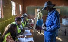 A voter waits for his name to be checked on the voter's roll before casting his vote in Zimbabwe's presidential elections on 30 July 2018. Picture: Thomas Holder/EWN