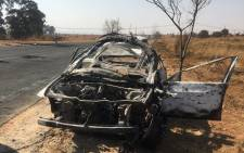 A car that was set alight by protesting residents in Lenasia south on Thursday, 1 August 2019. Picture: Edwin Ntshidi/EWN