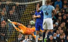 Manchester City's Vincent Kompany's shot beats Leicester City's goalkeeper Kasper Schmeichel. Credit: AFP