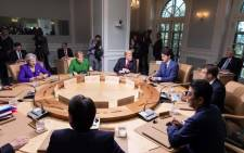 President Donald Trump and Group of Seven leaders during a meeting on the second day of a two-day summit in Canada. Picture: @Scavino45/Twitter.