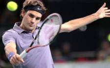 Roger Federer hits during Paris Masters 1000 ATP tournament quarter-final on 12 November 2010. Picture: Jacques Demarthon/AFP