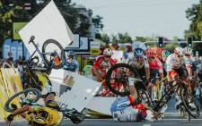 Dutch cyclist Fabio Jakobsen's bicycle (behind, L) flies through the air as he collides with compatriot Dylan Groenewegen (on the ground, L) during the opening stage of the Tour of Poland race in Katowice, southern Poland on 5 August 2020. Picture: AFP