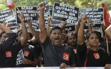 Members of the Central Trade Unions hold placards during a nationwide general strike called by trade unions aligned with opposition parties to protest the Indian government's economic policies in Hyderabad on 8 January 2020. Picture: AFP