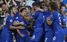 Chelsea's Spanish midfielder Pedro (3rd L) celebrates with teammates after scoring the opening goal of the English Premier League football match between Chelsea and Bournemouth at Stamford Bridge in London on 1 September 2018. Picture: AFP.
