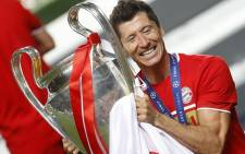 Bayern Munich's Polish forward Robert Lewandowski raises the European Champion Clubs' Cup during the trophy ceremony after winning at the end of the UEFA Champions League final football match between Paris Saint-Germain and Bayern Munich at the Luz stadium in Lisbon on 23 August 2020. Picture: AFP