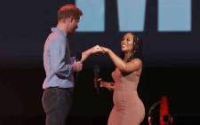 In this image released on 2 May, Prince Harry, Duke of Sussex, and South African actress and human rights activist, Nomzamo Mbatha, speak onstage during Global Citizen VAX LIVE: The Concert To Reunite The World at SoFi Stadium in Inglewood, California. Picture: Kevin Winter/Getty Images for Global Citizen VAX LIVE/AFP