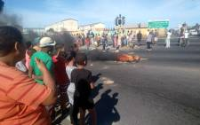 Community members in Parkwood, Cape Town, took to the streets and set tyres alight during a protest on Human Rights Day. Picture: Supplied.