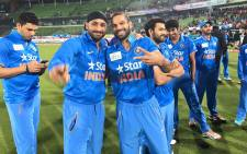 Shikhar Dhawan and Harbhajan Singh are all smiling after winning the Asia Cup title. Picture: Indian Cricket Team official Facebook page.
