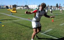 Springbok conditioning Coach Derrick Coetzee  puts Pat Lambie through his paces at a training camp in Cape Town on 6 July 2011. Picture: Wesley Petersen/EWN