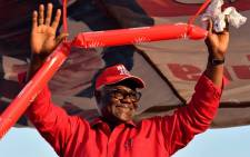 Sierra Leone's outgoing President Ernest Bai Koroma waves to supporters during a campaign rally for his party's presidential candidate on March 3, 2018, in Kambia, ahead of the country's general election. Picture: AFP.
