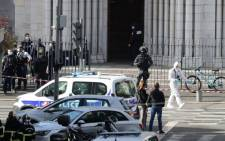French members of the elite tactical police unit RAID enter to search the Basilica of Notre-Dame de Nice after a knife attack in Nice on 29 October 2020. Picture: AFP