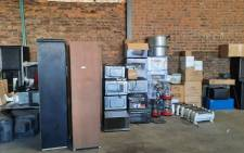 uMgungundlovu District police are hard at work recovering looted goods packed in a store house on 18 July 2021. Picture: SAPS.