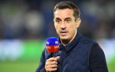 FILE: Sports commentator and former footballer Gary Neville gestures before the English Premier League football match between Brighton and Hove Albion and West Ham at the American Express Community Stadium in Brighton, southern England on 5 October 2018. Picture: AFP