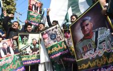 Pakistani traders shout slogans and carry posters with the image of Pakistani Army Chief General Qamar Javed Bajwa during an anti-India protest, in Lahore on 5 March 2019. Picture: AFP
