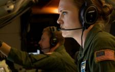 This video grab shows members of the US Navy Patrol and Reconnaissance Wing (CPRW) 11 on a P8-A Poseidon aircraft assisting the Argentine military in their search for the missing Argentine submarine ARA San Juan, on 26 November 2017. Picture: AFP