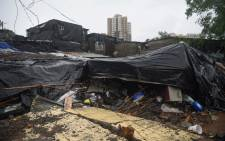 A general view shows shanty homes after a wall collapsed on them early morning in Mumbai on 2 July 2019. At least 15 people were killed in India's financial capital of Mumbai early on 2 July when a wall collapsed during torrential monsoon downpours. Picture: AFP