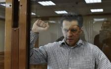 Journalist Roman Sushchenko, who worked for Ukrainian state news agency Ukrinform for over a decade, gestures in the court in Moscow on 4 June 2018. Picture: AFP