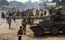 French troops of the Sangaris Operation take position with a Sagaie tank in the PK12 district of Bangui on 16 January, 2014. At least seven people were killed in overnight violence in Bangui, according to a compiled toll from the Red Cross and AFP. Picture: AFP