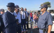 Police Minister Bheki Cele and Western Cape Police Commissioner Khombinkosi Jula visiting Browns Farms near Nyanga after the death of four people. Picture: Monique Mortlock/EWN
