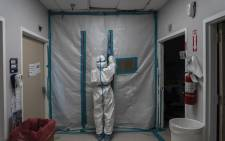 A medical staff member exits the COVID-19 intensive care unit on New Year's Day at the United Memorial Medical Center on 1 January 2021 in Houston, Texas, in the United States. Picture: AFP.