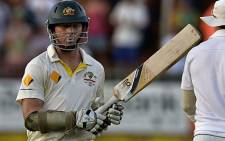 Australia's cricketer Chris Rogers reacts after falling for 107 runs during the second test match South Africa vs Australia at St George's Park in Port Elizabeth on February 23, 2014. Picture: AFP.
