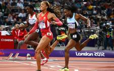 USA's Sanya Richards-Ross crosses the finish line to win the women's 400m finals at the London 2012 Olympic Games. Picture: AFP