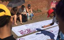 "Rhodes University Students writing messages in support of the anti-rape campaign, ""We will not be silenced"" on 20 April 2016. Picture: Govan Whittles/EWN."