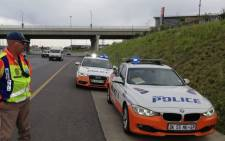 A JMPD officer conducts a roadside check in Johannesburg. Picture: @AsktheChiefJMPD/Twitter.
