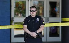 FILE: A police officer stands in front of The Grand Theatre in Lafayette, Louisiana. Picture: AFP.