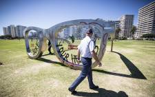 Sea Point promenade's Mandela-inspired glasses were vandalised by an activist group called Tokolos Stencil on 18 November 2014. Picture: Thomas Holder/EWN.