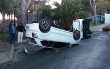 A car turned over by protesting Imizamo Yethu residents.  Picture: Supplied.