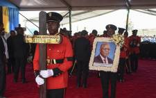 Personnel of the Tanzania People's Defence Force (TPDF) moves the coffin of the late Tanzanian President John Magufuli for the burial after the farewell mass at Magufuli Stadium in Chato, Tanzania, on 26 March 2021. Picture: AFP