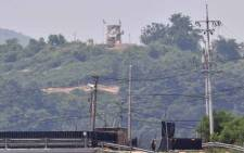 A North Korean guard post (top) is seen over a South Korean military fence (bottom) from the border city of Paju on 16 June 2020. Picture: AFP.