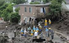 Members of Self-Defense Forces and police officers search for missing persons at the scene of a landslide following days of heavy rain in Atami, in Shizuoka Prefecture on July 5, 2021. Picture: STR / JIJI PRESS / AFP
