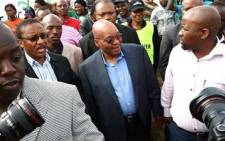 FILE: ANC President Jacob Zuma arrives at the Ntolwane Primary School in Nkandla to vote. Picture: AFP