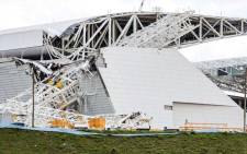 FILE: Damages at the Arena de Sao Paulo stadium, where the opening match of the 2014 FIFA World Cup is to be hosted, after a crane fell across part of the metallic structure, on November 27, 2013 in Sao Paulo. Picture: AFP.